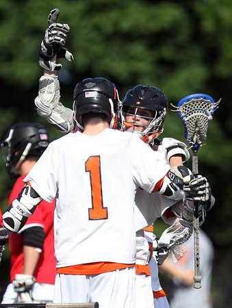 Beverly junior Nick Albano, right, celebrates his first half goal with junior Ian Butler (1). Behind four goals and five assists from junior attack Nick Albano the Panthers downed the Magicians 12-6 to capture the D2 North Title at Bertram Field in Salem on Saturday afternoon. DAVID LE/Staff photo. 6/7/14.