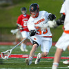 Beverly junior midfielder Bryan Flaherty taps the ball forward past a Marblehead player to gain control for the Panthers. Behind four goals and five assists from junior attack Nick Albano the Panthers downed the Magicians 12-6 to capture the D2 North Title at Bertram Field in Salem on Saturday afternoon. DAVID LE/Staff photo. 6/7/14.
