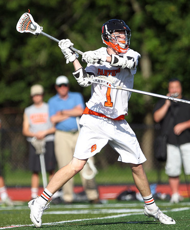 Beverly junior midfielder Ian Butler (1) a shot on net against Marblehead. Behind four goals and five assists from junior attack Nick Albano the Panthers downed the Magicians 12-6 to capture the D2 North Title at Bertram Field in Salem on Saturday afternoon. DAVID LE/Staff photo. 6/7/14.