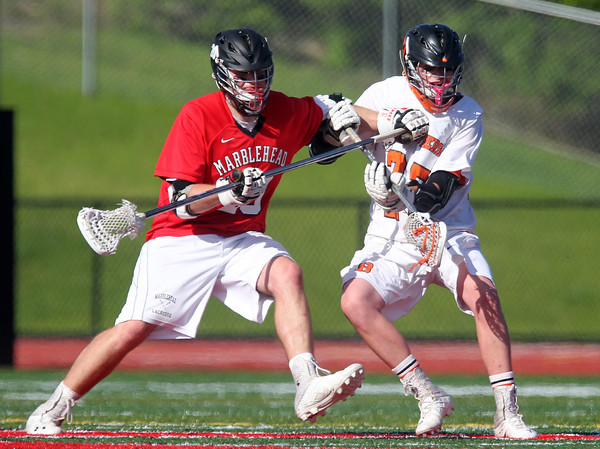 Marblehead junior Tommy Gabel (20) and Beverly senior Matt Page (27) battle for position for a ground ball. Behind four goals and five assists from junior attack Nick Albano the Panthers downed the Magicians 12-6 to capture the D2 North Title at Bertram Field in Salem on Saturday afternoon. DAVID LE/Staff photo. 6/7/14.