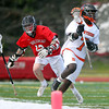 Beverly sophomore midfielder Peter Mulumba (7) escapes pressure from Marblehead senior Dean Fader (12) during the first half of play. Behind four goals and five assists from junior attack Nick Albano the Panthers downed the Magicians 12-6 to capture the D2 North Title at Bertram Field in Salem on Saturday afternoon. DAVID LE/Staff photo. 6/7/14.