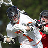 Beverly junior midfielder Ian Butler (1) wards off a check from Marblehead junior midfielder Brooks Tyrrell. Behind four goals and five assists from junior attack Nick Albano the Panthers downed the Magicians 12-6 to capture the D2 North Title at Bertram Field in Salem on Saturday afternoon. DAVID LE/Staff photo. 6/7/14.