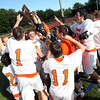 The Beverly Panthers celebrate their 12-6 win over Marblehead to earn the D2 North Title. Behind four goals and five assists from junior attack Nick Albano the Panthers downed the Magicians 12-6 to capture the D2 North Title at Bertram Field in Salem on Saturday afternoon. DAVID LE/Staff photo. 6/7/14.