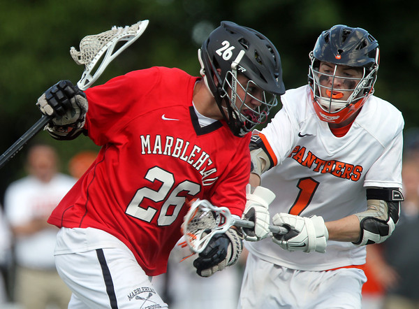 Marblehead junior midfielder Ben Anderson (26) puts his head down and tries to drive past Beverly junior midfielder Ian Butler (1). Behind four goals and five assists from junior attack Nick Albano the Panthers downed the Magicians 12-6 to capture the D2 North Title at Bertram Field in Salem on Saturday afternoon. DAVID LE/Staff photo. 6/7/14.