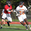 Marblehead junior midfielder Brooks Tyrrell (4) holds off Beverly senior Rick McFarland (25) as he tries to drive to the net. Behind four goals and five assists from junior attack Nick Albano the Panthers downed the Magicians 12-6 to capture the D2 North Title at Bertram Field in Salem on Saturday afternoon. DAVID LE/Staff photo. 6/7/14.