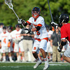 Beverly freshman midfielder Sam Abate (5) makes a quick pass. Behind four goals and five assists from junior attack Nick Albano the Panthers downed the Magicians 12-6 to capture the D2 North Title at Bertram Field in Salem on Saturday afternoon. DAVID LE/Staff photo. 6/7/14.