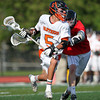 Beverly freshman midfielder Sam Abate (5) blows past Marblehead junior midfielder Liam Healy and drives to the net. Behind four goals and five assists from junior attack Nick Albano the Panthers downed the Magicians 12-6 to capture the D2 North Title at Bertram Field in Salem on Saturday afternoon. DAVID LE/Staff photo. 6/7/14.