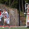 Beverly senior goalie Kevin Lally (2) makes a save on Marblehead senior Dean Fader (12). Behind four goals and five assists from junior attack Nick Albano the Panthers downed the Magicians 12-6 to capture the D2 North Title at Bertram Field in Salem on Saturday afternoon. DAVID LE/Staff photo. 6/7/14.