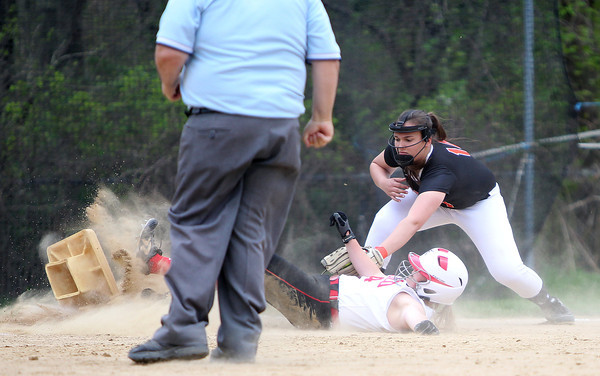 Masco senior Emily Dow kicks up a cloud of dirt as she slides safely into third base for a triple before Beverly third baseman Olivia George can apply the tag. DAVID LE/Staff photo. 5/15/14.