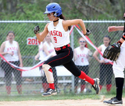 Masco senior Julianna Kostas (9) scampers home with another Chieftans run on a wild pitch against Beverly on Thursday afternoon. DAVID LE/Staff photo. 5/15/14.