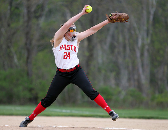 Masco senior starting pitcher Emily Dow fires a pitch against Beverly on Thursday afternoon in non-league action. DAVID LE/Staff photo. 5/15/14.