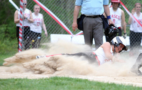 Masco junior Jordyn Murray (2) slides home in a cloud of dust on a sacrifice fly from sophomore Kylie Currier against Beverly on Thursday afternoon. DAVID LE/Staff photo. 5/15/14.