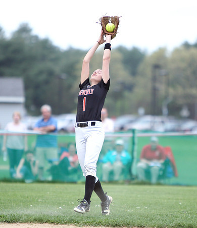 Beverly shortstop Hannah Silvestri reaches above her head to track down a short popup in centerfield. DAVID LE/Staff photo. 5/15/14.
