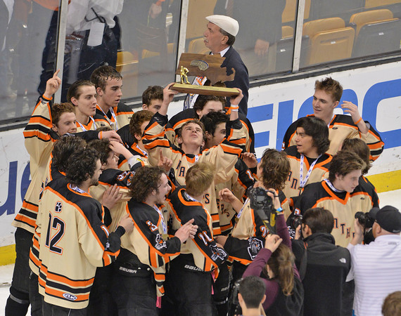 Beverly celebrates with the MIAA plaque after clinching the Division 2 state championship over Medfield at the TD Garden. Staff photo by Desi Smith