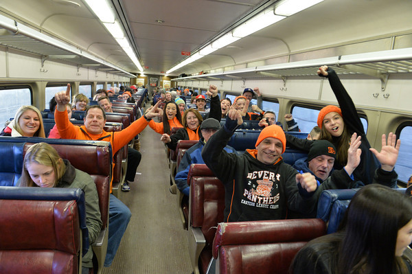 Fans ride the train into Boston.<br /> Staff photo by Desi Smith