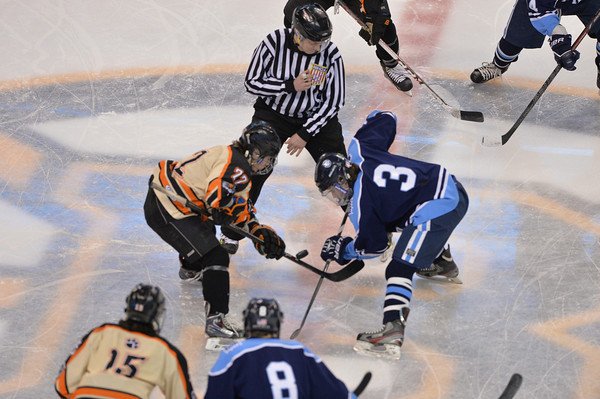 Beverly's Connor Irving takes the face of the Div 2 State Championship finals against Medfield last night at the TD Garden in Boston. Staff photo by Desi Smith
