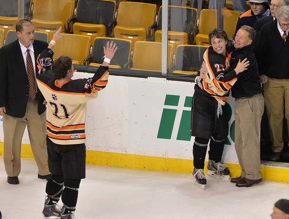 Beverly's Connor Irving, 22, celebrates with Head Coach Bob Gilligan as Graham Doherty comes to join them.Staff photo by Desi Smith