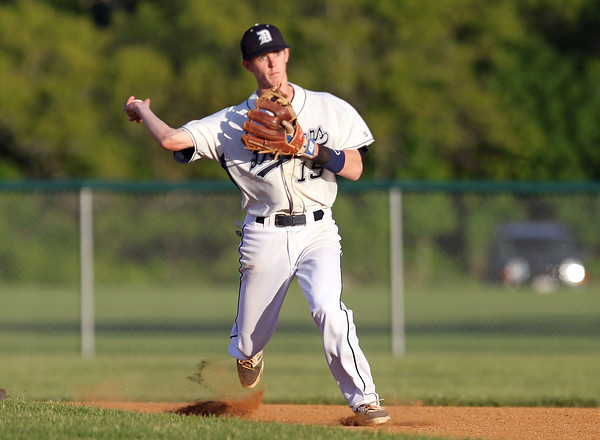 Danvers shortstop Andrew Olszak fires to first to retire a Dracut batter on Sunday evening. DAVID LE/Staff photo. 6/1/14.