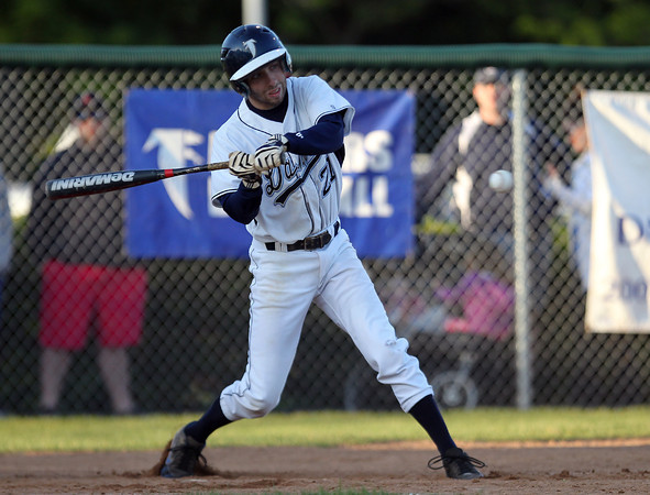 Danvers cleanup hitter Ryan Kelleher lines a RBI single off Dracut starter Dan Zabbo on Sunday evening. DAVID LE/Staff photo. 6/1/14.