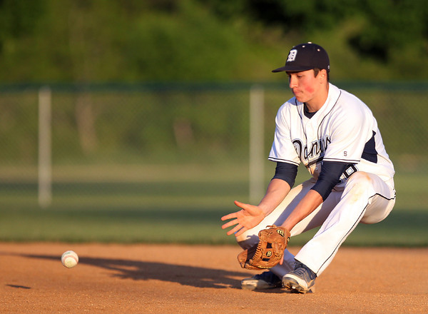 Danvers junior second baseman Richie Martino concentrates on reeling in a sharp grounder against Dracut. DAVID LE/Staff photo. 6/1/14.