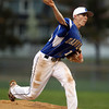 Danvers sophomore Andrew Olszak fires a strike against Salem on Friday evening. DAVID LE/Staff photo. 5/9/14.