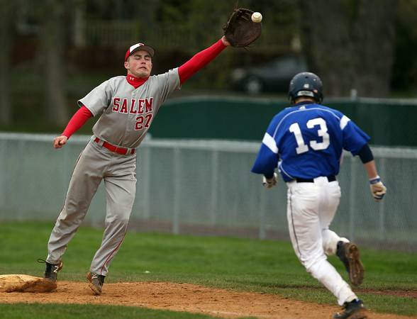 Salem first baseman Josh McRae (27) stretches for a throw from pitcher Sammy Ramirez as Danvers freshman Jordan DeDonato (13) bears down. DAVID LE/Staff photo. 5/9/14.