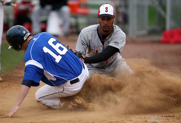 Danvers junior Richie Martino (16) slides in safely home before Salem pitcher Sammy Ramirez can apply the tag. DAVID LE/Staff photo. 5/9/14.