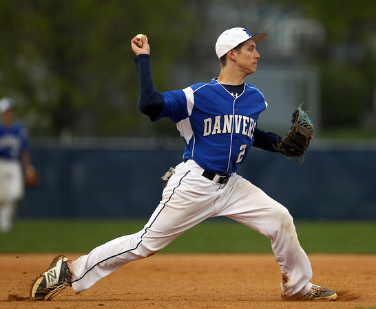 Danvers junior third baseman Will Eary (2) slings the ball over to first to retire a Salem batter on Friday evening. DAVID LE/Staff photo. 5/9/14.