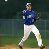 Danvers freshman shortstop Devonn Allen (8) fires to first to retire a Salem baserunner on Friday evening. DAVID LE/Staff photo. 5/9/14.