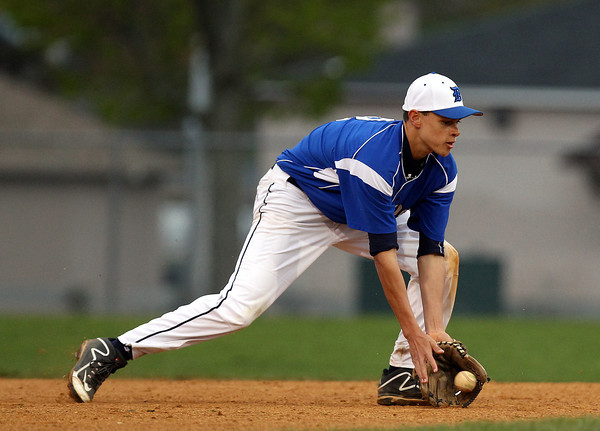 Danvers freshman shortstop Devonn Allen (8) cleanly fields a grounder and throws to first to retire a Salem runner. DAVID LE/Staff photo. 5/9/14.
