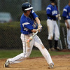 Danvers sophomore Andrew Olszak lines a base hit against Salem on Friday evening. DAVID LE/Staff photo. 5/9/14.