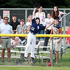 Hamilton-Wenham center fielder Eli Leonard makes a leaping catch at the fence to rob a Barnstable home run. The Generals lost to Barnstable 12-1 in a shortened 4 inning contest on Friday evening at Harry Ball Field in Beverly. DAVID LE/Staff photo. 7/25/14.