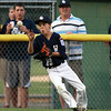Hamilton-Wenham center fielder Lenny Dolan concentrates on fielding a one hopper in the outfield. The Generals lost to Barnstable 12-1 in a shortened 4 inning contest on Friday evening at Harry Ball Field in Beverly. DAVID LE/Staff photo. 7/25/14.