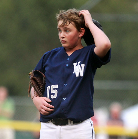 Hamilton-Wenham starting pitcher Aidan Cann can only scratch his head after a long home run by Barnstables Bennett Teceno during the first inning of play. The Generals lost to Barnstable 12-1 in a shortened 4 inning contest on Friday evening at Harry Ball Field in Beverly. DAVID LE/Staff photo. 7/25/14.