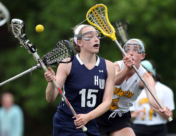 Hamilton-Wenham's Catherine Ecker (15) loses the ball while being hassled defensively by Bishop Fenwick's Merry Harrington. The Crusaders barely edged out the Generals 8-7 with two late goals by Merry Harrington in the first round of the MIAA D2 state tournament at Donaldson Field at Bishop Fenwick High School on Tuesday afternoon. DAVID LE/Staff photo. 5/27/14.