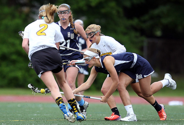 Hamilton-Wenham's Eliza Roberts, right, tries to scoop up a ground ball while being pursued by Bishop Fenwick's Natalie Emerson, center, and Merry Harrington, left. The Crusaders barely edged out the Generals 8-7 with two late goals by Merry Harrington in the first round of the MIAA D2 state tournament at Donaldson Field at Bishop Fenwick High School on Tuesday afternoon. DAVID LE/Staff photo. 5/27/14.