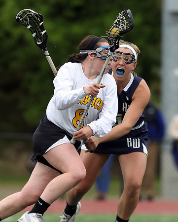 Bishop Fenwick's Tessa McLaughlin (8) tries to drive past Hamilton-Wenham's Hannah Johnson (5) on Tuesday afternoon. The Crusaders barely edged out the Generals 8-7 with two late goals by Merry Harrington in the first round of the MIAA D2 state tournament at Donaldson Field at Bishop Fenwick High School on Tuesday afternoon. DAVID LE/Staff photo. 5/27/14.