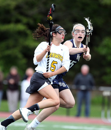 Bishop Fenwick's Annette Ruggiero (5) drives hard to the net while being defended by Hamilton-Wenham's Catherine Ecker (15) during the first half of play. The Crusaders barely edged out the Generals 8-7 with two late goals by Merry Harrington in the first round of the MIAA D2 state tournament at Donaldson Field at Bishop Fenwick High School on Tuesday afternoon. DAVID LE/Staff photo. 5/27/14.