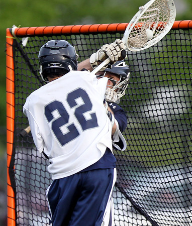 Hamilton-Wenham senior goalie Grant Thompson makes a point blank save on Cohasset junior Adam Benson (22). The Generals fell to the Skippers 10-6 in the D3 State semifinal at Woburn High School on Wednesday evening. DAVID LE/Staff photo. 6/11/14