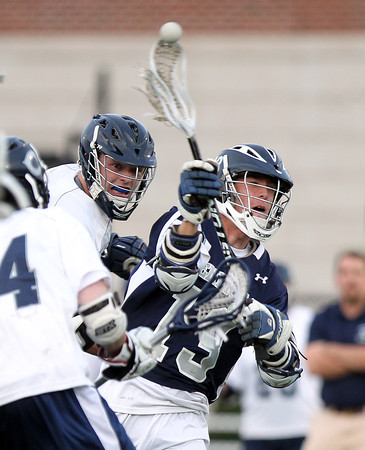 Hamilton-Wenham senior captain Matt Curran rifles home a goal amidst a crowd of Cohasset defenders. The Generals fell to the Skippers 10-6 in the D3 State semifinal at Woburn High School on Wednesday evening. DAVID LE/Staff photo. 6/11/14