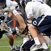 Hamilton-Wenham senior captain Matt Curran (13) gets leveled by Cohasset senior Will Golden (19). The Generals fell to the Skippers 10-6 in the D3 State semifinal at Woburn High School on Wednesday evening. DAVID LE/Staff photo. 6/11/14