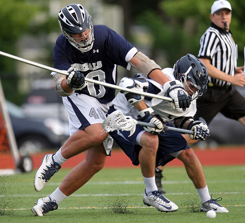 Hamilton-Wenham senior defense Alex Rogers (40) shoves down a Cohasset player as they battle for a ground ball during the second quarter of play. The Generals fell to the Skippers 10-6 in the D3 State semifinal at Woburn High School on Wednesday evening. DAVID LE/Staff photo. 6/11/14