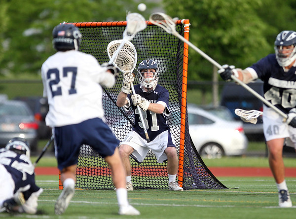 Hamilton-Wenham senior goalie Grant Thompson (31) keeps his eyes right on a shot from Cohasset junior Cole Kissick (27). The Generals fell to the Skippers 10-6 in the D3 State semifinal at Woburn High School on Wednesday evening. DAVID LE/Staff photo. 6/11/14