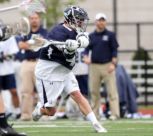 Hamilton-Wenham senior midfielder Brian Shaw (4) rips a shot on net against Cohasset. The Generals fell to the Skippers 10-6 in the D3 State semifinal at Woburn High School on Wednesday evening. DAVID LE/Staff photo. 6/11/14