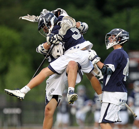 Hamilton-Wenham junior Jake Stahlman (3) celebrates his goal with junior Sam Petri and senior Brian Shaw (4). The Generals fell to the Skippers 10-6 in the D3 State semifinal at Woburn High School on Wednesday evening. DAVID LE/Staff photo. 6/11/14