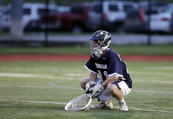 Hamilton-Wenham senior captain Grant Thompson kneels on the field as time expires as the Generals fell to Cohasset 10-6 in the D3 State semifinal at Woburn High School on Wednesday evening. DAVID LE/Staff photo. 6/11/14