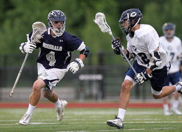 Hamilton-Wenham senior midfielder Brian Shaw charges through the offensive zone while being pursued by Cohasset junior Matt Arnold (12). The Generals fell to the Skippers 10-6 in the D3 State semifinal at Woburn High School on Wednesday evening. DAVID LE/Staff photo. 6/11/14
