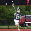 Hamilton-Wenham senior Parker Strong (19) makes a pass on a man-up advantage against Cohasset on Wednesday. The Generals fell to the Skippers 10-6 in the D3 State semifinal at Woburn High School on Wednesday evening. DAVID LE/Staff photo. 6/11/14