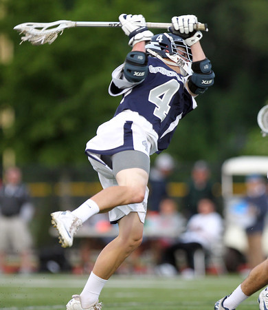 Hamilton-Wenham senior midfielder Brian Shaw (4) takes a leaping shot against Cohasset. The Generals fell to the Skippers 10-6 in the D3 State semifinal at Woburn High School on Wednesday evening. DAVID LE/Staff photo. 6/11/14