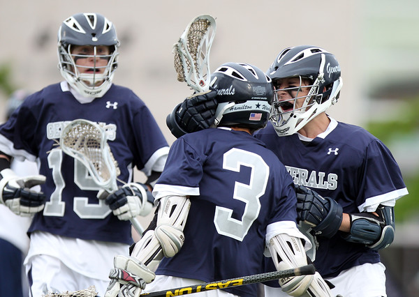 Hamilton-Wenham junior attack Jake Stahlman (3) celebrates his goal with freshman Alex Winch (8). The Generals fell to the Skippers 10-6 in the D3 State semifinal at Woburn High School on Wednesday evening. DAVID LE/Staff photo. 6/11/14